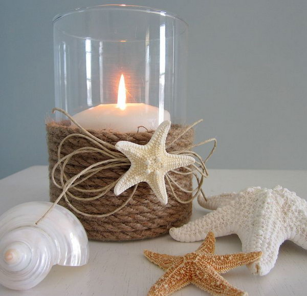 DIY Nautical Rope and Starfish Candle Holder. A plain and common mason jar decorated with the nautical rope and starfish turns to be this chic nautical decor candle holder.