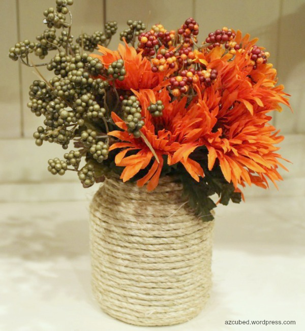 DIY Rope Wrapped Vase. A vase, some ropes, hot glue gun and hot glue are all you need to make this rope wrapped vase. It will be an amazing table centerpiece with some fall flowers and leaves in.