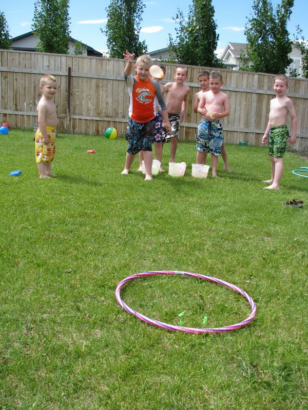 Water Balloon Target Toss. Pull out the hula hoop and toss your water balloons at the target. You can group the players and count how many each team hits the target to raise the team spirit for kids in this funny game.