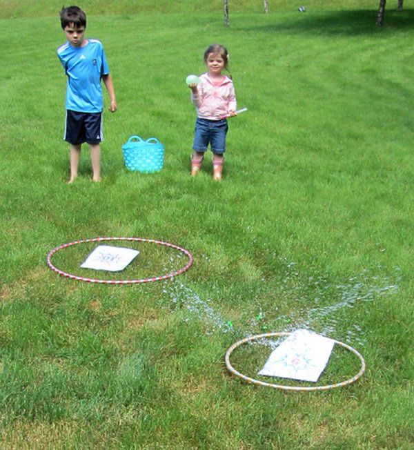 Water Balloon Math Game. It's a good way to have fun and learn math. Make the targets with hoops and place numbers inside. Mark the water balloon with equations equal the numbers on the target. Get ready and toss at the target.