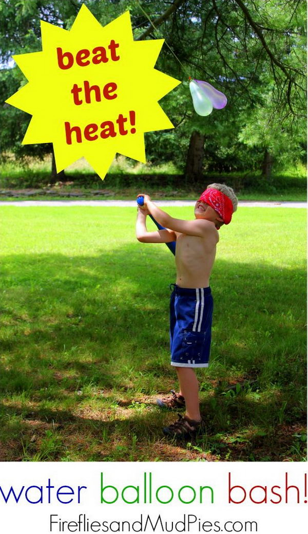 Blind Water Balloon Bash. Hang colorful water balloons on a line. Use opaque cloth to cover the eyes of the kids. Ask the kids to hit the water balloon with a stick. The one who bats the most win this game. It's funny and interesting for the kids to beat the heat off.