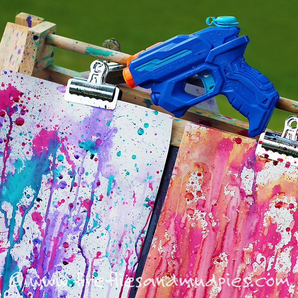 Squirt gun painting. This fun art project is such an awesome summer activity  Hang up a few white sheets on a line. Fill up water guns with different water colors and let the kids make their masterpiece.