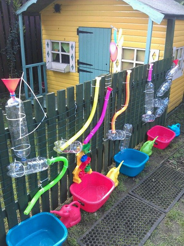 Keep your little ones busy. Great for warmer weather fun. Tack PVC bottles and pipes to a wooden post . Add water, get fun!