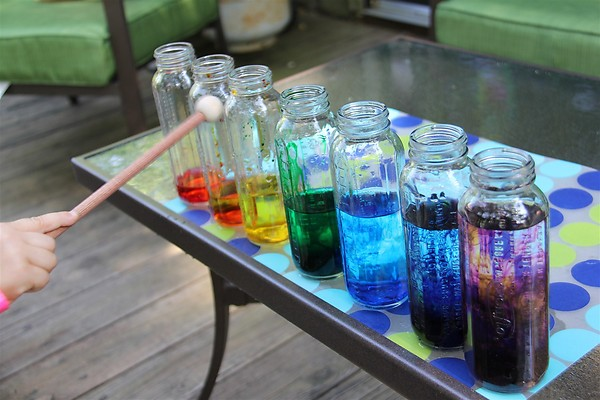 Music in the glass. Pour different amounts of water into glass bottles, you can offer your child a wonderful game to play a familiar melody. Tap the glasses with different meterials like spoons, forks, pencils.