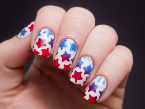Stenciled Star Nail Art: This stenciled star design is a trendy take on flag inspired nails. Start with a pearl white base. Then use stenciled stars to draw blue and white stars with a nail art brush! Have a look at the tutorial here.