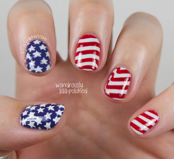 Simple Stars and Stripes 4th of July Nail Art: This manicure is so simple and cute. Stamped white stars onto blue base of two nails, and freehand red stripes on white gradient of the other three nails. The subtle gradient really makes the whole thing pop. See the tutorial here.