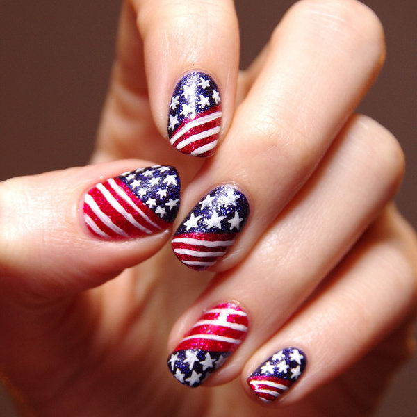 Patriotic Glitter Stars and Stripes Nail Art: Go with the classic patterns, but use glitter polish. Your nail art looks totally something but tacky. See the tutorial here.