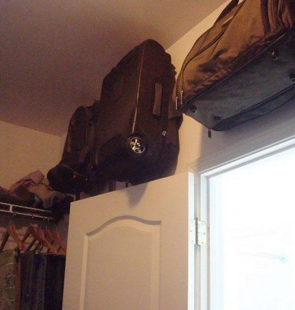 Store Suitcase in the Space above the Closet Door on Hooks