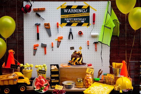 Construction Themed Birthday Decoration: Green, orange and yellow color construction themed birthday decoration. I love the tools attached to the white board as an accent wall.