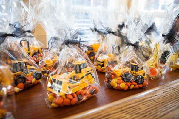 Workbench Dessert Table: When it's time for your guests to leave, the goodie bag with a truck in it will be a great gift.
