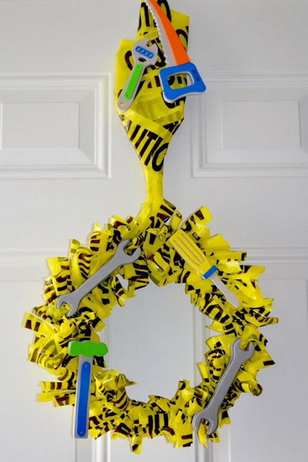 Truck Themed Birthday Party Decor: Attach recyclables to an old coat hanger with a sign to create a cool entry sign for your little boy's truck party.