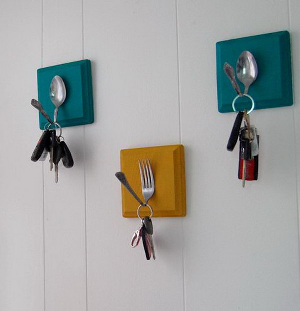 DIY Key Holder with Old Spoons and Forks. A creative way to transfer the old utensils into a key holder. Have some small blocks of wood painted, secure them to the wall, then glue on bent utensils for a pretty way to never lose your keys again. Follow the tutorial