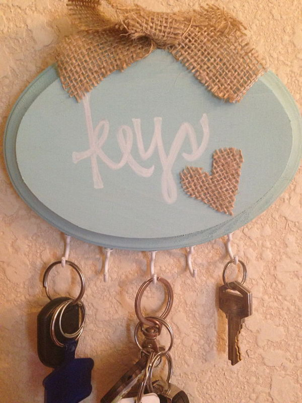 Shabby Chic Handmade Key Holder. A traditional and nautical piece with aquamarine paint, white plastic hooks, burlap heart and burlap bow decorated on top and 'Keys' written in white! It is an addition to your chic, rustic or even beach home. See more
