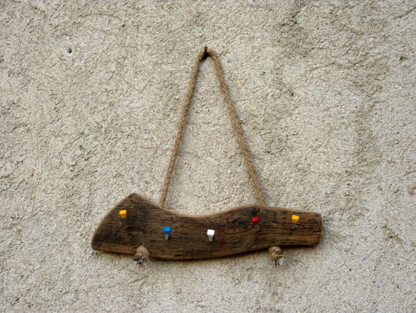 Wall Hanging Wood Key Holder. This key holder idea needs very little effort to complete. Just attach some colorful hooks to a piece of old solid wood ,then hang it on the wall with rope and you've got yourself a beautiful and functional key holder. See more