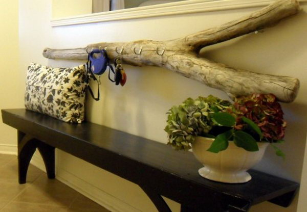 DIY Driftwood Key Holder. Driftwood is easy to find if you live somewhere near a beach. Drill holes to accommodate all hooks with screws. Then hang it up on your wall. It is a great place to hang your keys. See more instructions