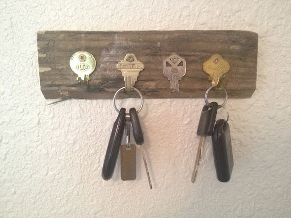 DIY Key Holder Using Old Keys. Here is another opinion regarding DIY key holders.  Get old and unwanted keys bent and secured them on a rectangle piece of wood.  A functional and cheap key holder is here for you. See how to do it