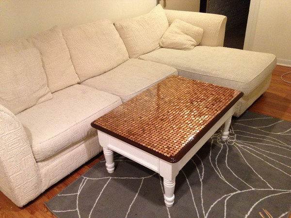 Penny Top Coffee Table DIY. Considering giving your coffee table a unique treatment. You can use a collection of pennies to give a copper patina to the tabletop. See how to do it