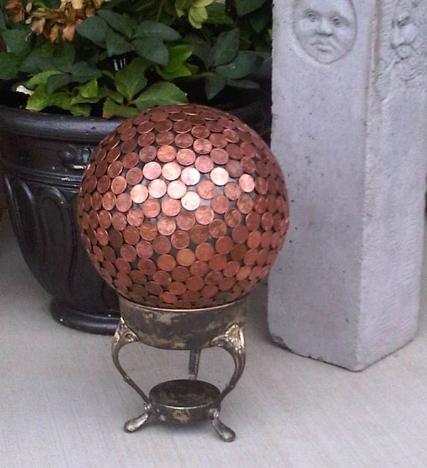 Penny Gazing Ball Yard Art.   Add year round color to your garden with  fabulous art projects you can make yourself. This gazing ball made with pennies will add more style to your landscape. See how to do it