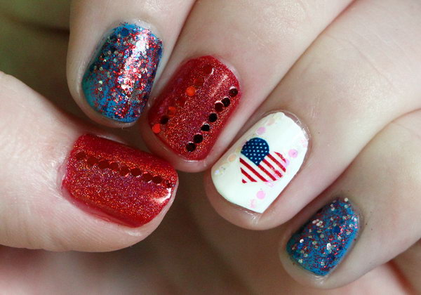 Patriotic Red, White, Blue and Sparkly Nails: This 4th of July sparkly nail design accented with a flag decal to show some love on the Fourth of July is a perfect way to keep your patriotism looking pretty. See the tutorial here.