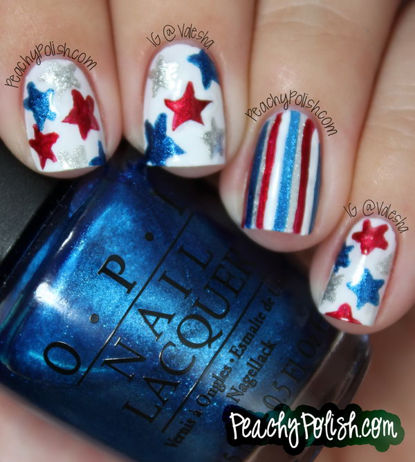 Patriotic Glitter Stars and Stripes Nail Art: Freehand glitter stars and stripes on the white base coats and you're ready to be rocking with this clean and elgant manicure. See the tutorial here.