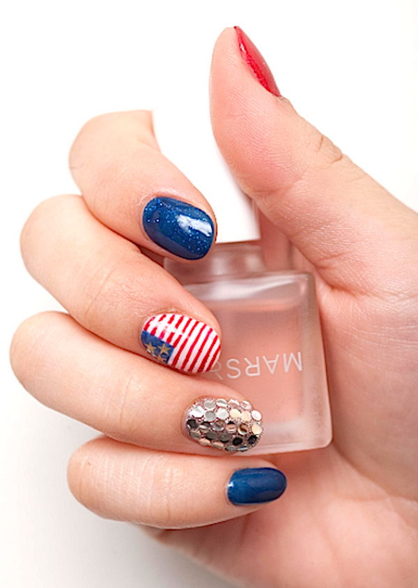 Patriotic American Flag Nails:  Try this glamorous American flag nail art, using red and blue polish with flecks of glitter, gold rhinestones and an American flag with mini stripes and stars. Then get ready to be rocking. See the tutorial