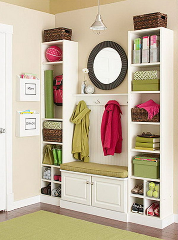 Create this mini mudroom from IKEA Billy Bookcases and a bit of beadboard and trim. It costs not much and looks like custom built ins! A super inexpensive DIY project. Get more details