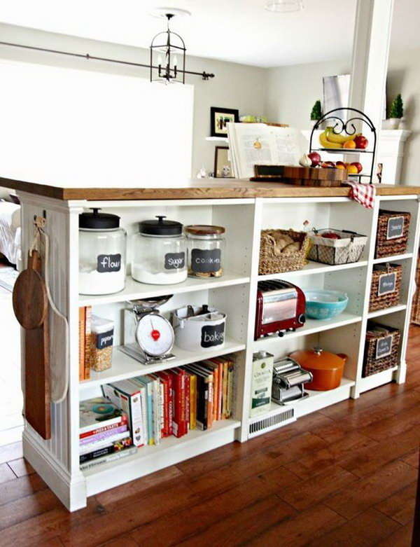 DIY Kitchen Island. This kitchen island is composed of an IKEA butcher block and three BILLY bookcases. You can also give the island a more custom look with moulding and beadboard on the side. See more details