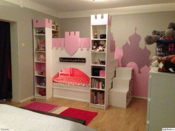 Castle bed with upper play deck using an IKEA Kura bed and two BILLY bookcases. See more at