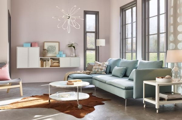 In this living room, the blue sofa matches the light pink painting wall very much. This color combination features a very peaceful and girly girl's living room. The light blue sofa from IKEA lay beside the window create more warmth and comfy to this living space.