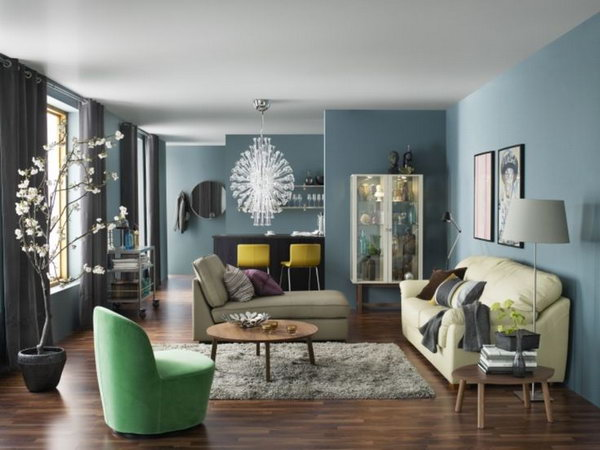 Blue is a popular color during the summer time. The blue-painted walls make a sophisticated and chic living room. Every wall can be a stunning display place in your living space.