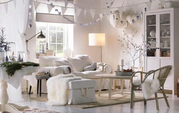 Living Room Inspired by Winter. This living room can be called a white winter wonderland with the lighting, soft textiles, snow globes and decorative paper chains.  All of these keep the fairytale and romance feeling alive in the room.