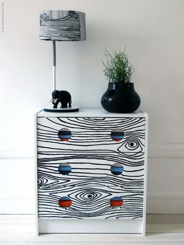 Give your plain IKEA RAST dresser a unique look with a faux bois print. See more instructions