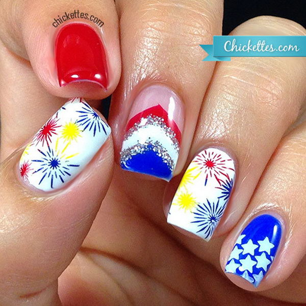 Glittery Fireworks Nails: This is quite a sparkling festive manicure to celebrate the great birthday of America! The idea of sliver, white, blue and red stripes is so creative. With this manicure, you're sure to be rocking.