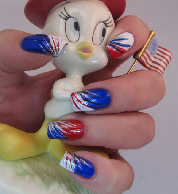 Red, White, Blue and Silver Stripes: This one is very easy to re create. Apply a color to each nail and then paint a diagonal tip on each one. Add red, white, blue and silver stripes with brushes and it's done. See the tutorial