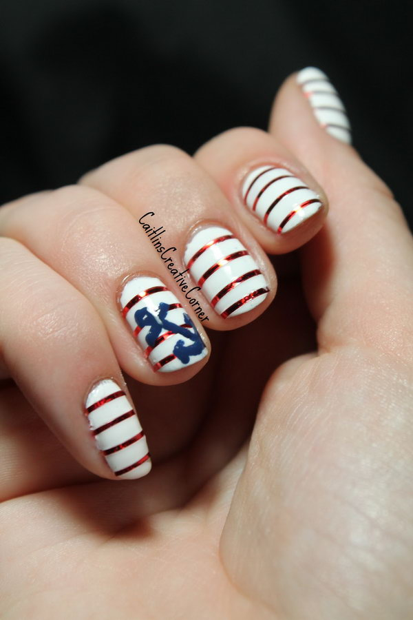Nautical 4th of July Stripes with an Anchor Accented Nails: This beautiful nautical theme inspired nail art is easy to recreate. Use red metallic striping tape to add stripes onto the base and use a dotting tool to paint the anchor. You're able to get the fancy look.