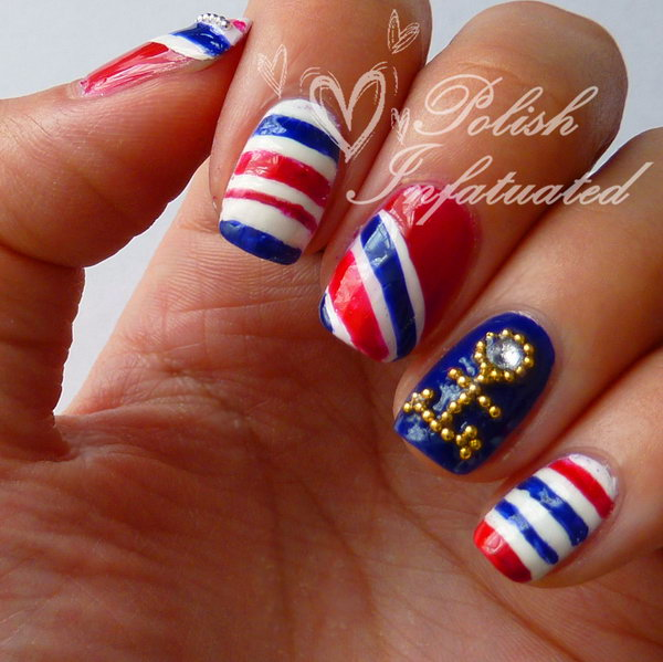 Nautical 4th of July Stripes with a Gold Anchor: Go for the gold with a touch of shine, this manicure looks much more luxury and fancy now. See the tutorial