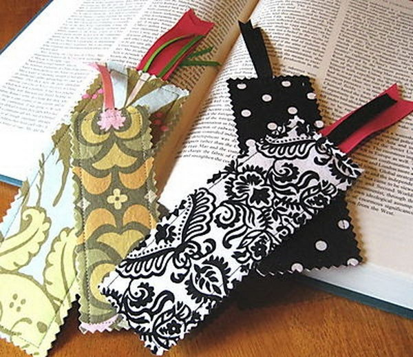 DIY Fabric Bookmarks.  Make bookmarks with pretty scalloped edges and ribbon tails! They are the ideal gifts for your friends who are a bookworm. Get tutorials