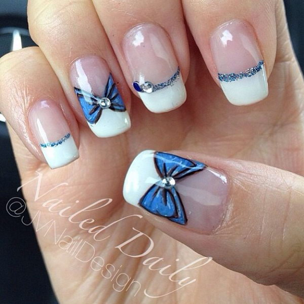 White Tips Nail Design With Blue Bows