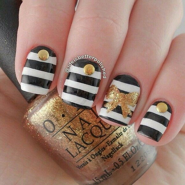 Zebra Nails with Gold Glitter Bows.