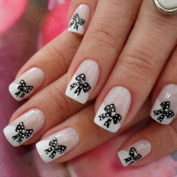 Pink and White Nail Art with Black Bows.