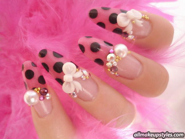 Gorgeous Pink and Black Nails with Golden Zircons and Bows.