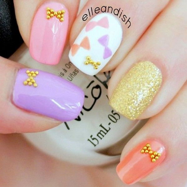 45 wonderful bow nail art designs hative gold studded bow nail prinsesfo Images