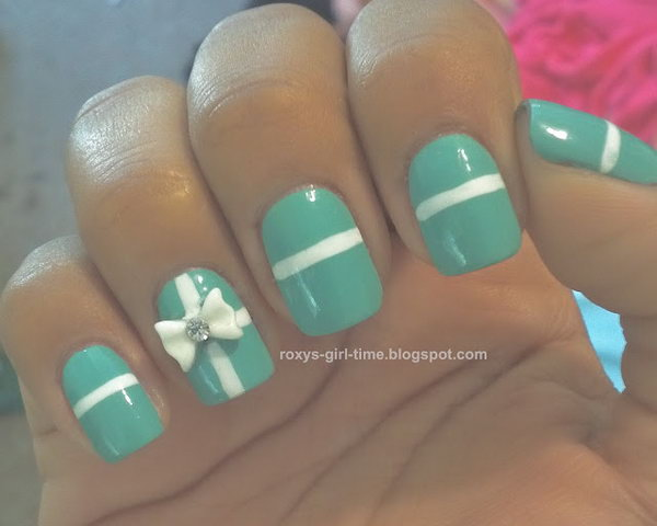 Green Nails with White Bow and Strips. See more details