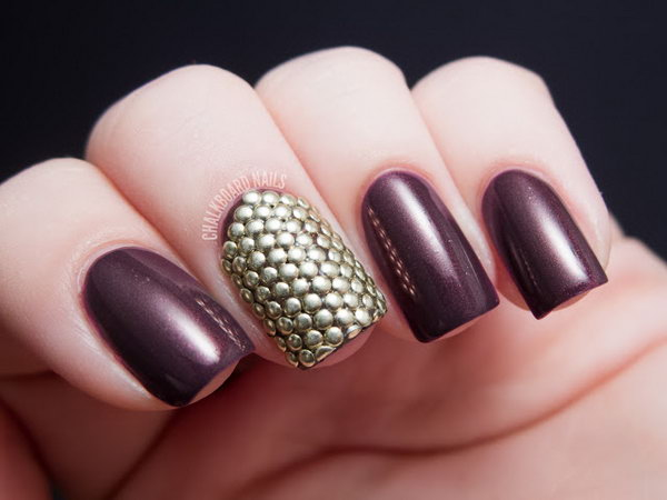 Purple Background with Stud Armor Accent Nail.