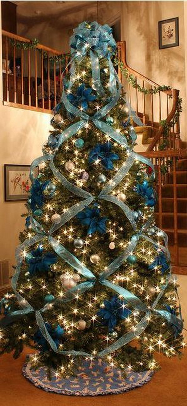 beautiful christmas tree decorating with cross ribbon - White Christmas Tree With Blue And Silver Decorations
