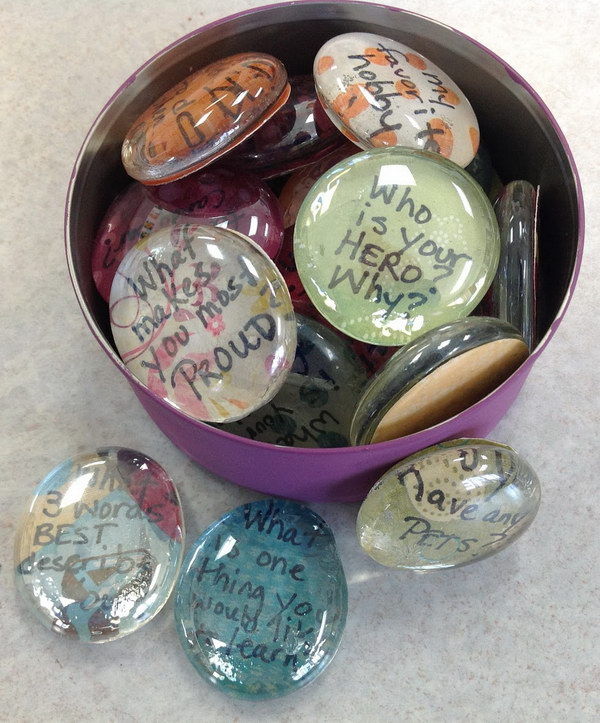 Icebreaker Question Stones. Use glass pebbles, scrapbook paper and Mod Podge to create some question stones. Give your icebreaker questions a new look.