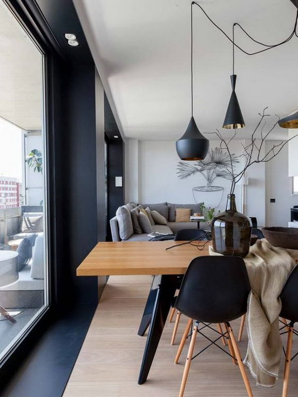 Modern Living Room With Black Chairs And Lighting.