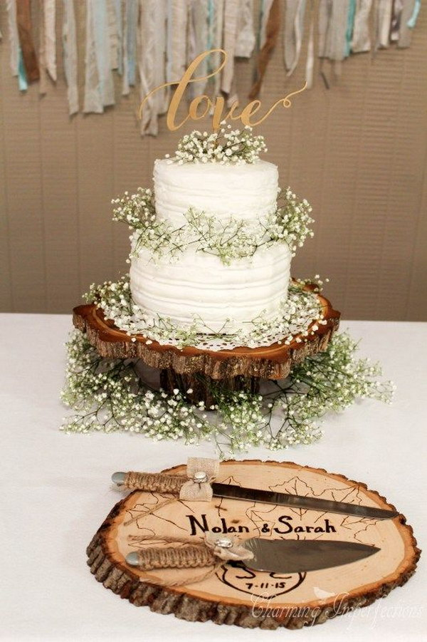 Rustic Wedding Cake with Tree Stump and Baby Breath