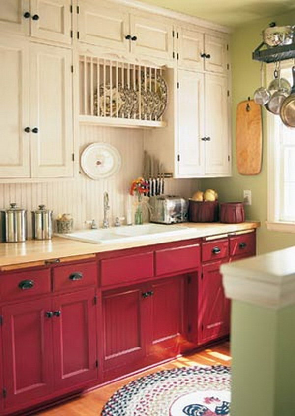 cranberry colored and cream kitchen cabinets