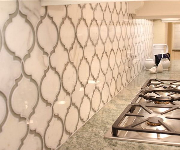 Stunning Calcutta Gold Marble and Grey Glass Backsplash with Beautiful White Cabinetry
